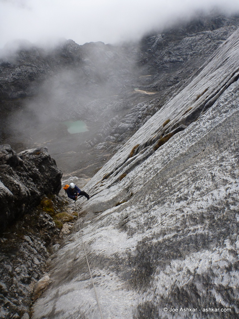 Climbing up the fixed lines on Carstensz.