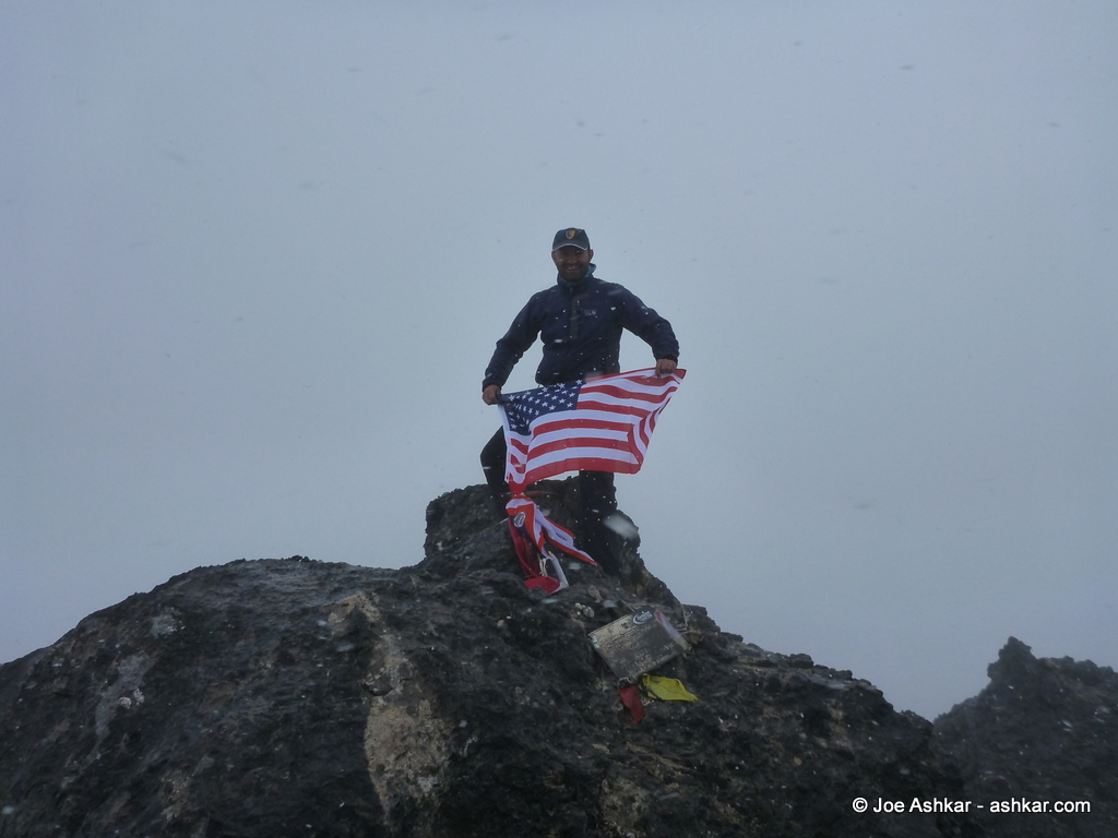 Joe Ashkar on the Summit of Carstensz Pyramid, Puncak Jaya.