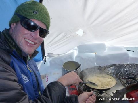 Garrett scrambling Huevos for breakfast.