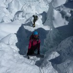 Climbing up & down vertical ladders in the Icefall.